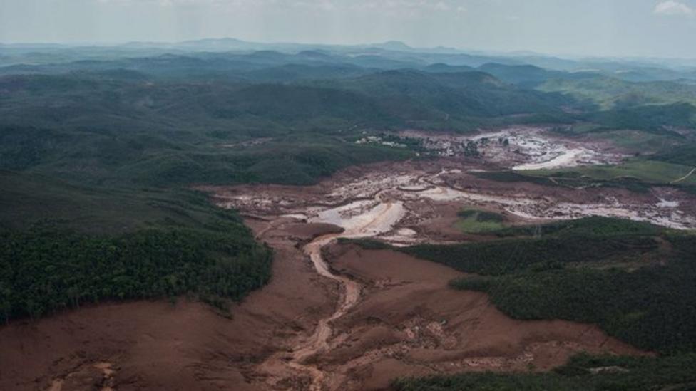 Toxic mud spill reaches ocean