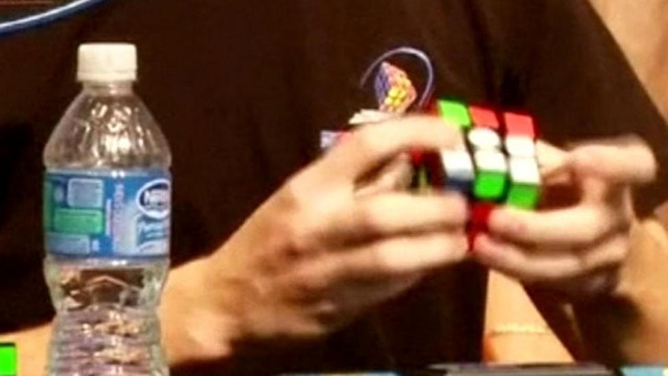 Rubik's champion wins in 5.695 seconds