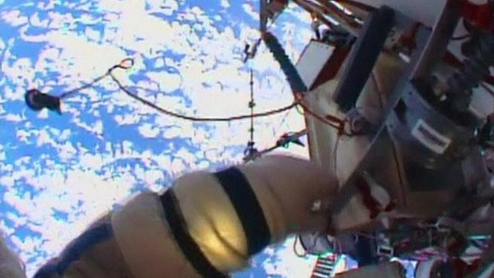 Cosmonauts cleaning windows in space