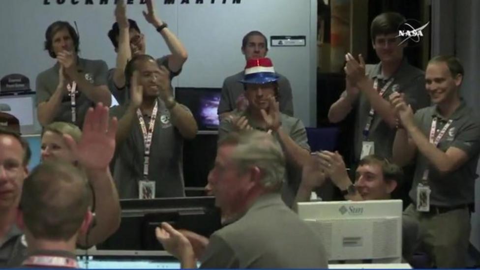 Nasa scientists celebrate Jupiter orbit