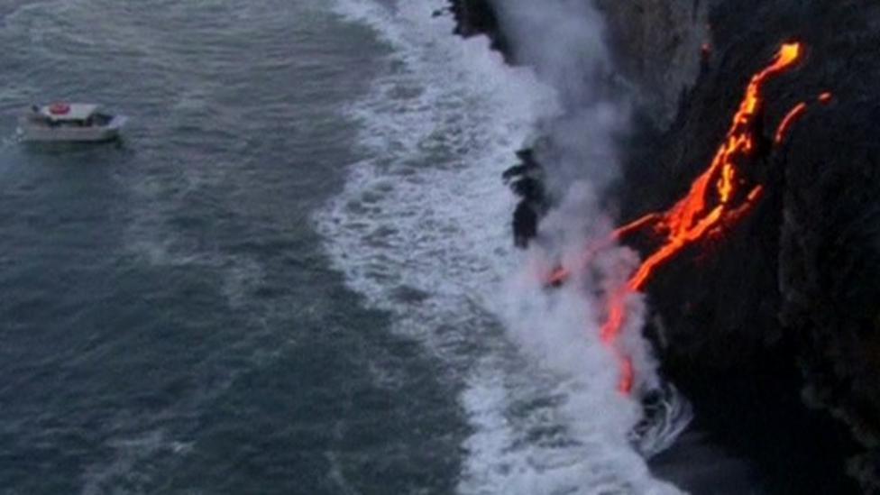 Lava from volcano spills into ocean
