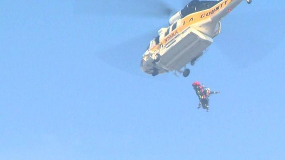 Fire helicopter lifts driver to safety
