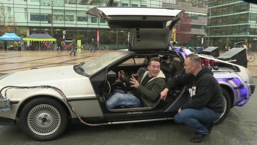 Martin gets in a famous DeLorean car
