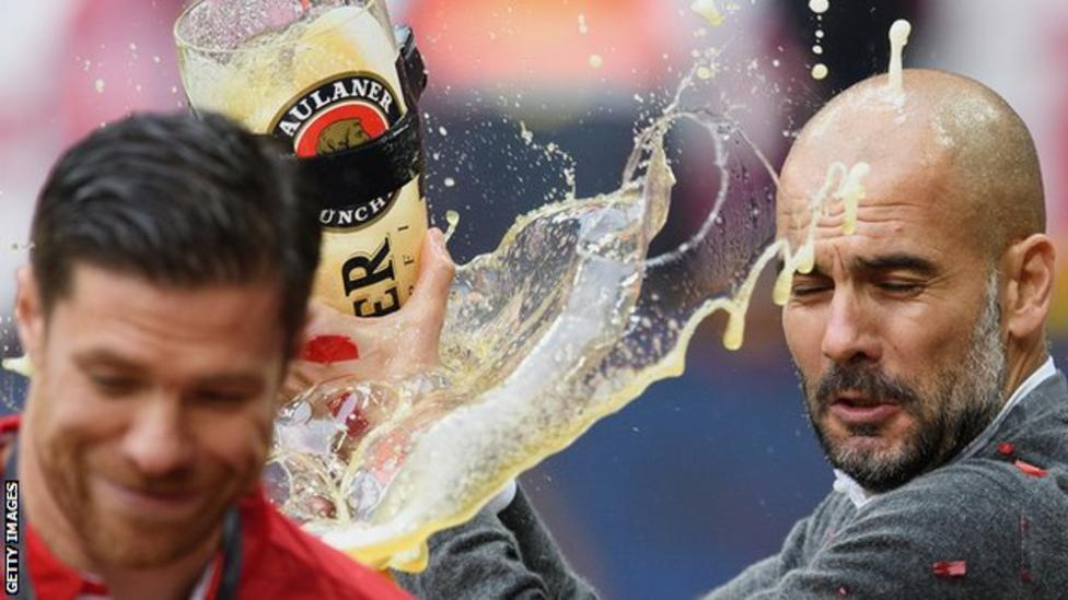 Pep Guardiola celebrates with giant beer