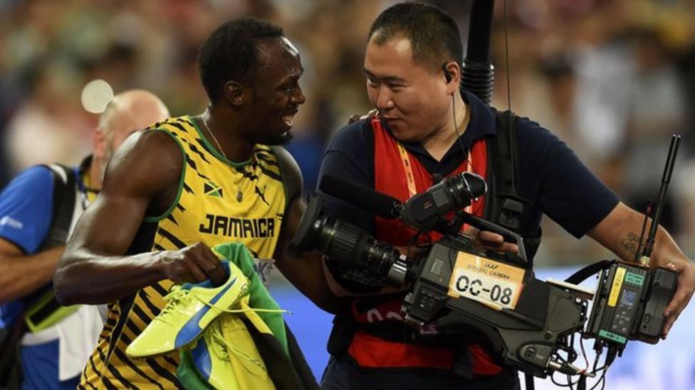 Usain Bolt takes a tumble