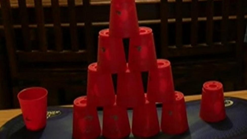 Watch boy's super-fast cup stacking