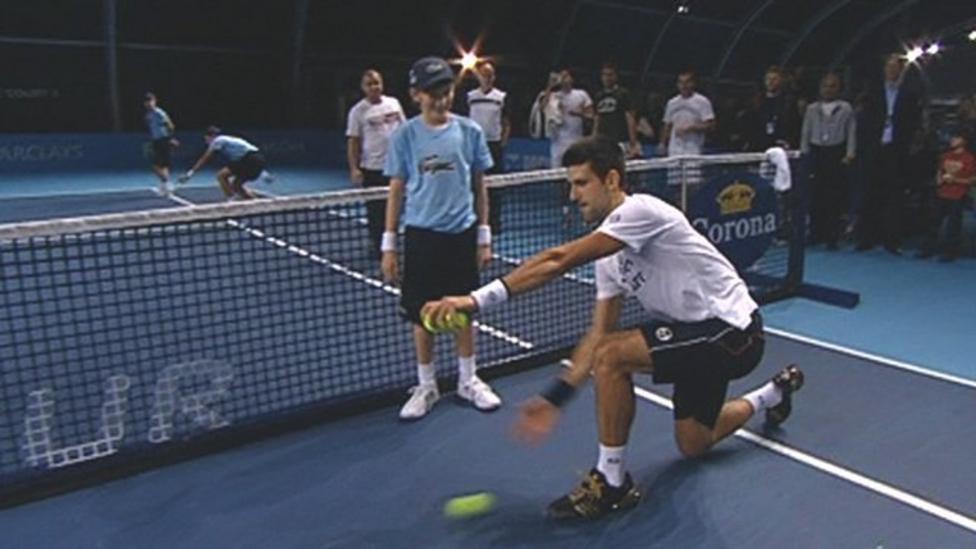 Novak Djokovic Learns The Art Of Being A Ball Boy Bbc Sport
