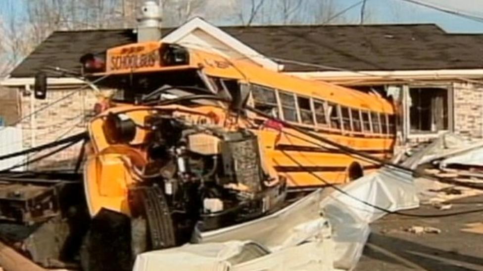 Tornado throws school bus in air