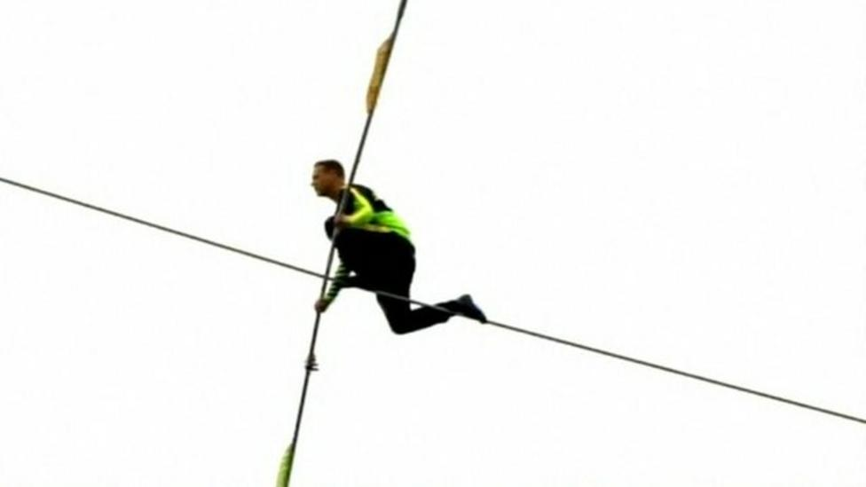 Terrifying trip on a tightrope!