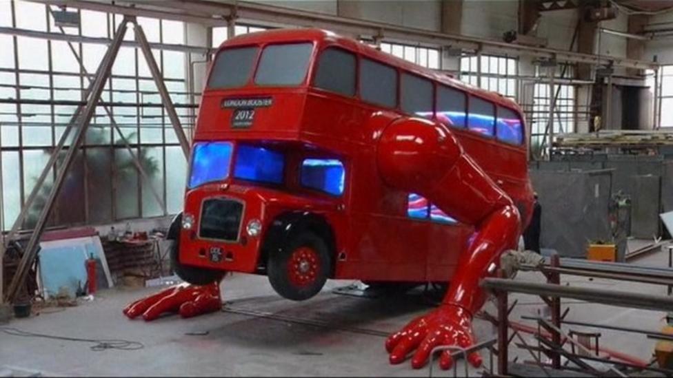 Double decker bus does push-ups