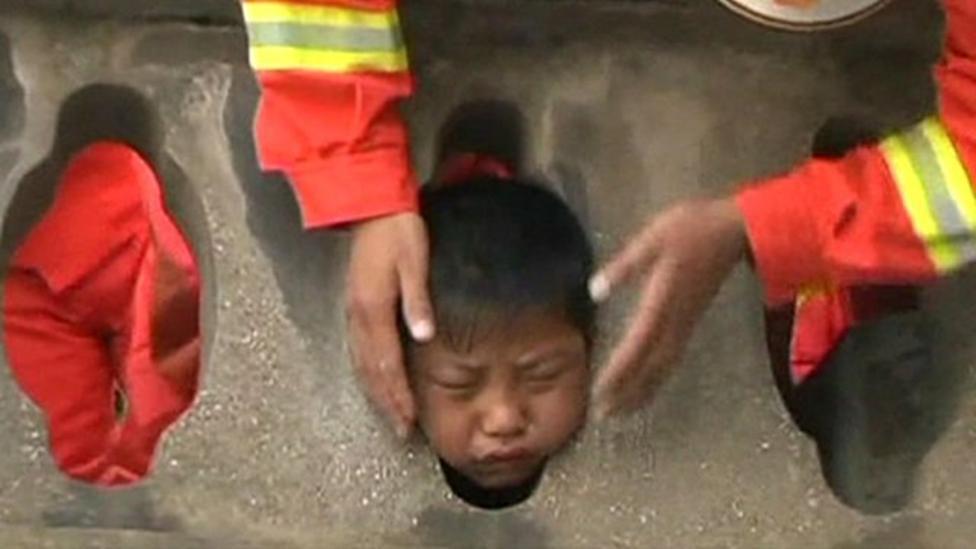 Boy gets head stuck in balcony