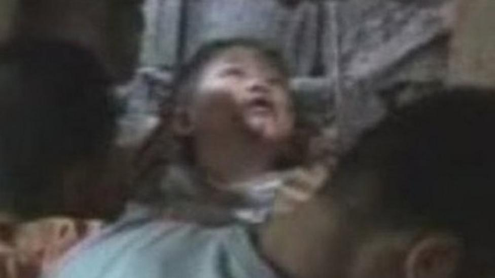 Boy trapped between walls rescued