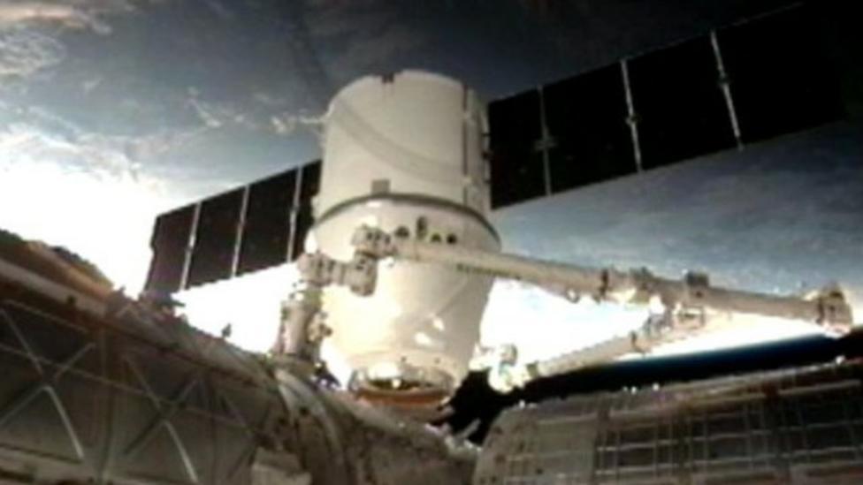 Supply ship docks at International Space Station