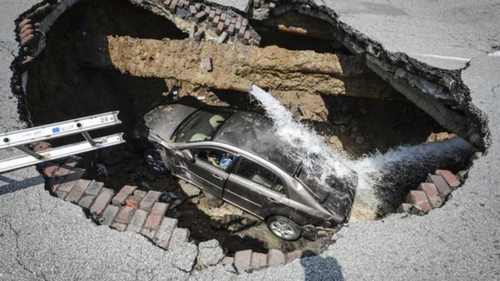Escape after sinkhole swallows car