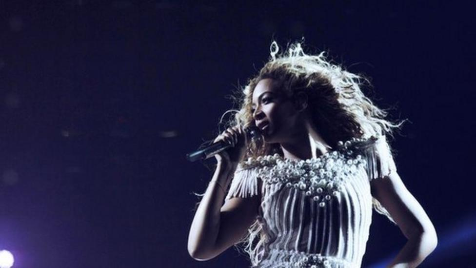 Beyonce gets her hair caught in a fan