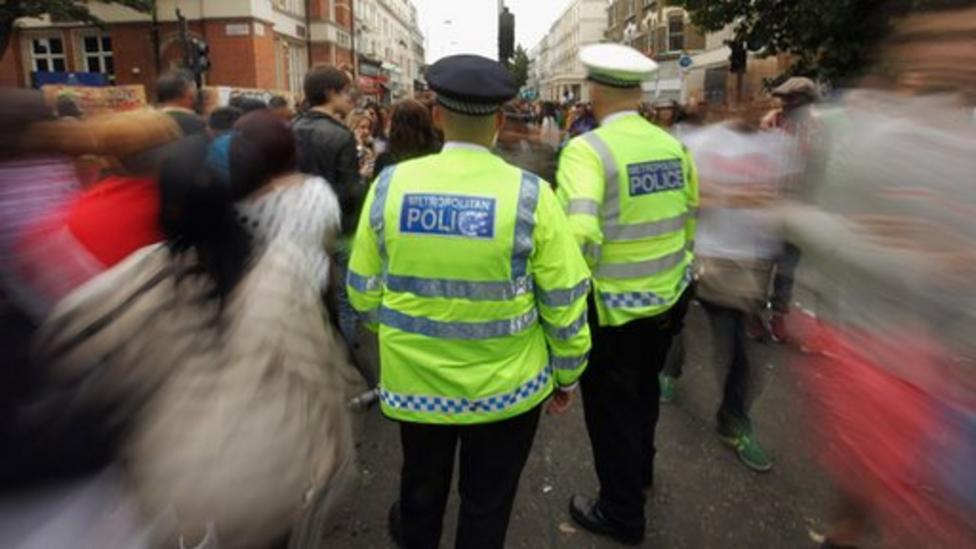 Police officers dance at Carnival