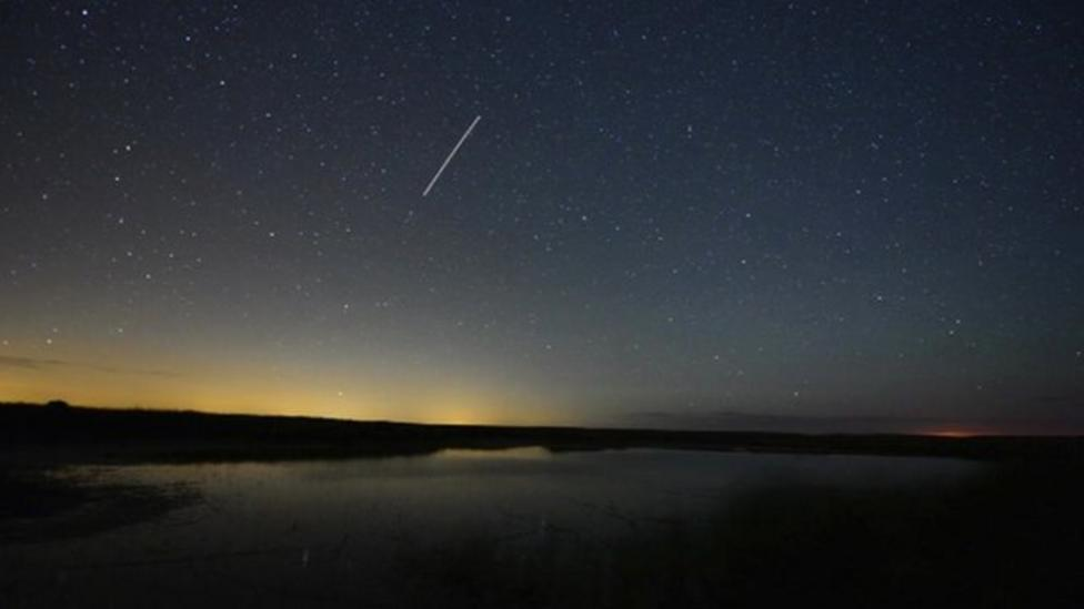 Falling star 'captured' over marshes