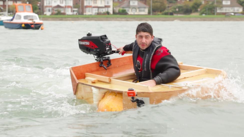 Artist sets pumpkin boat records
