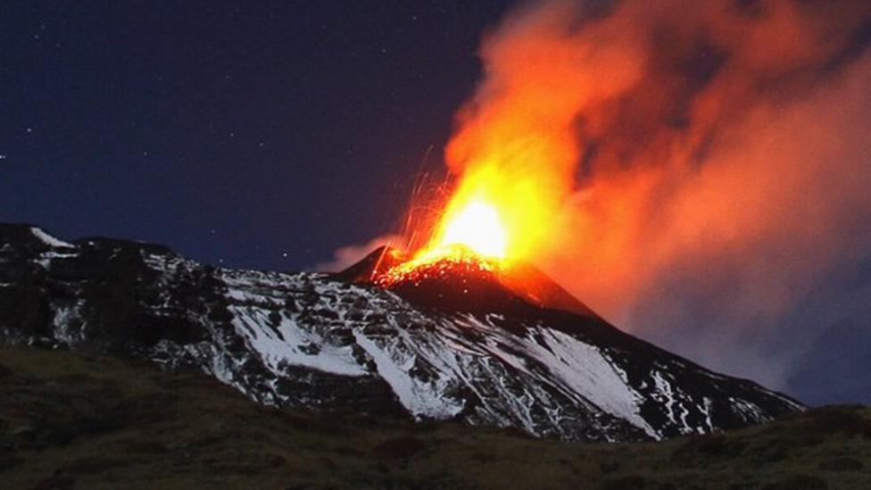 Mount Etna lights up night sky