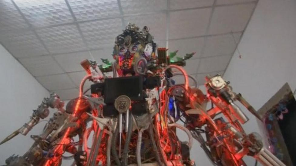 Giant robot built in man's house