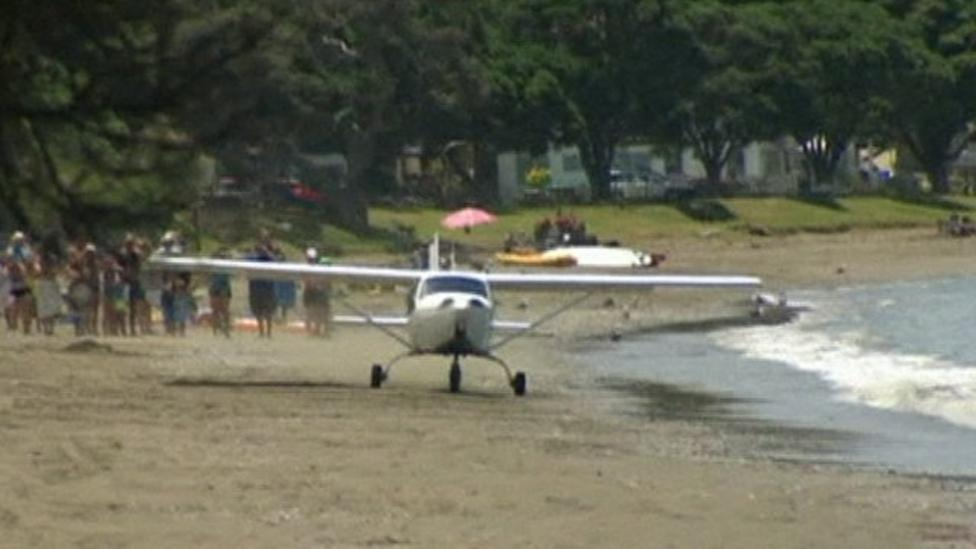 Plane lands on beach in New Zealand