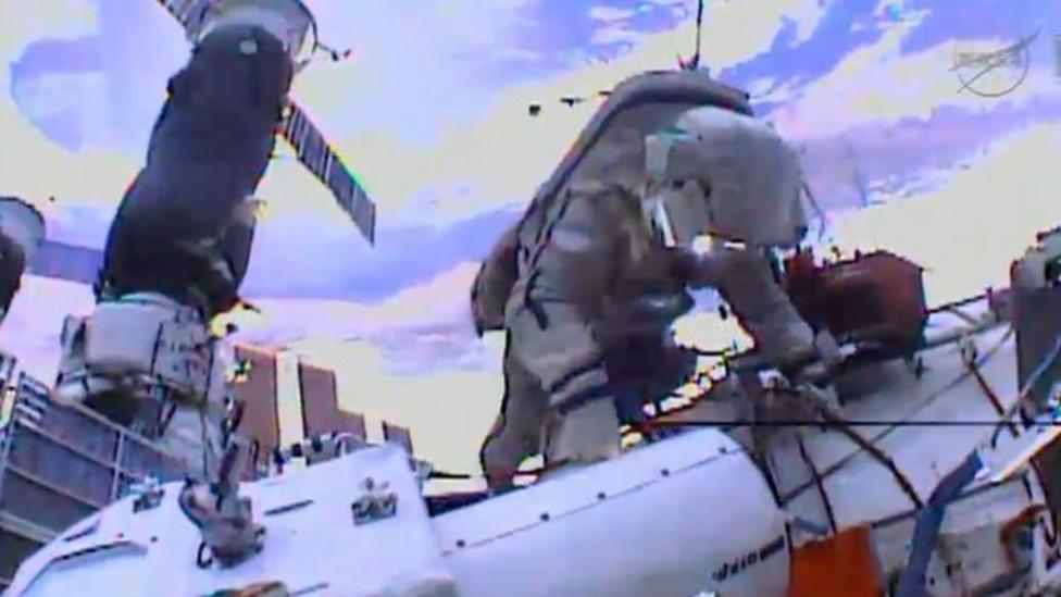 Astronauts install cameras on space station