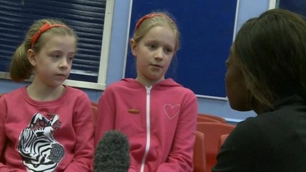 Children chat about life in the floods