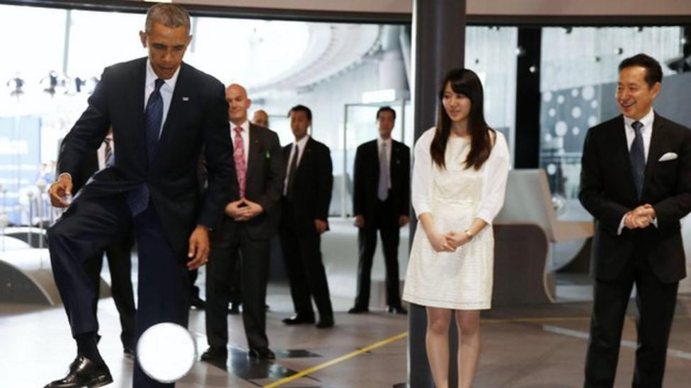 Obama plays football with robot