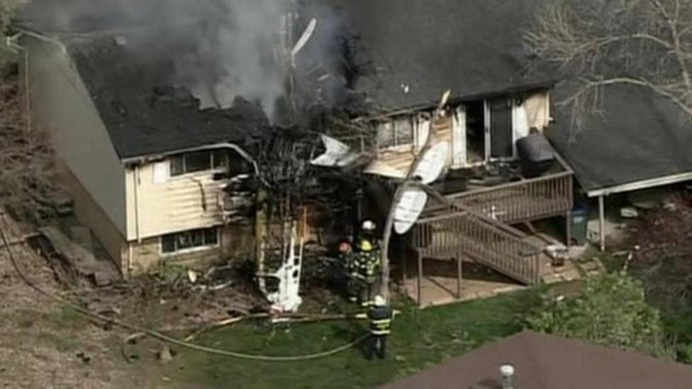 Plane crashes into empty house