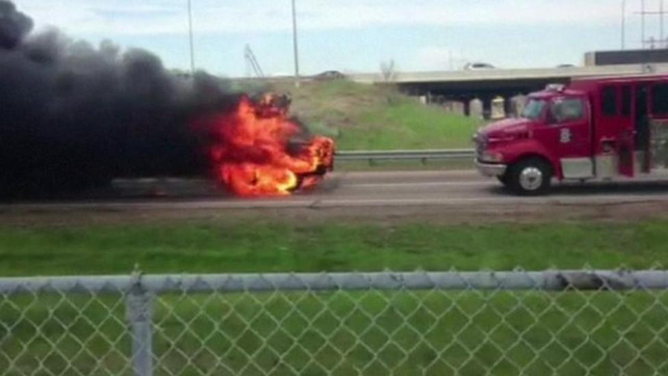 Blazing bus nearly hits fire truck