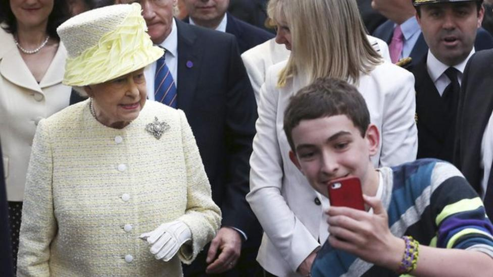 Boy takes selfie with the Queen