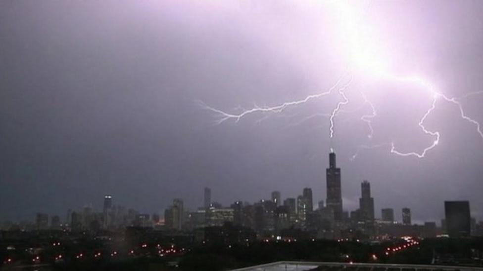 Three lightning bolts hit skyscraper