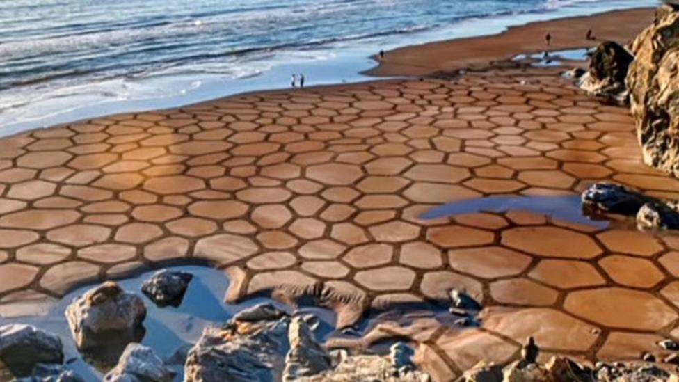 Beautiful art drawn in the sand