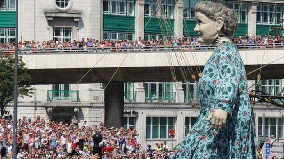 Liverpool crowds greet giant puppets