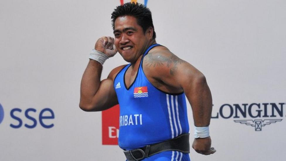 Weightlifter dances to historic gold
