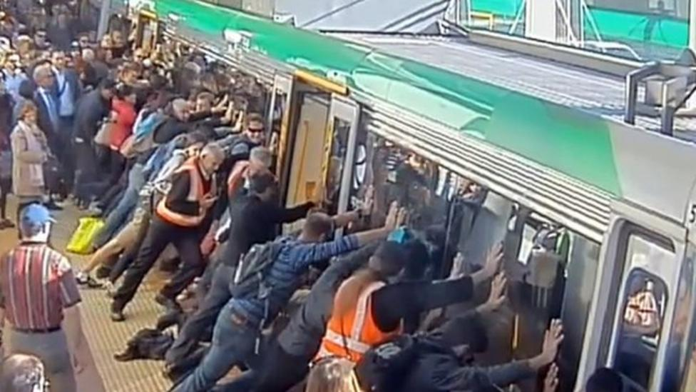 Australians rescue man stuck on train