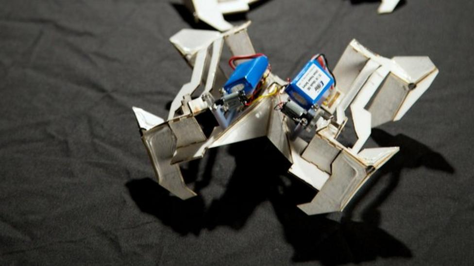 Robots fold into action