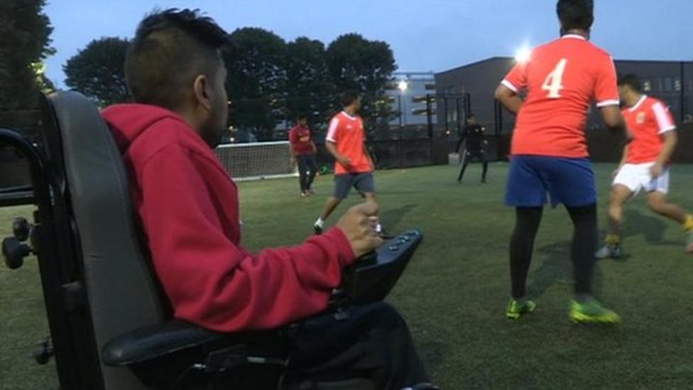 World's first wheelchair footy coach