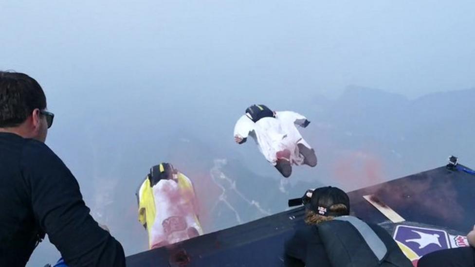 Wingsuit jumpers in downhill sky race
