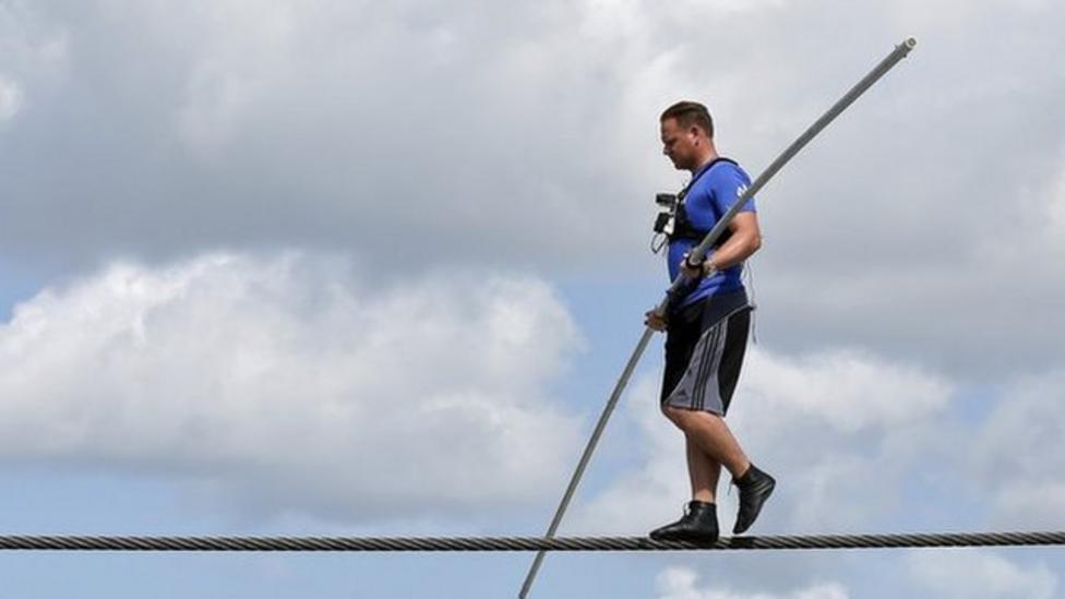 Tightrope walker in dangerous challenge