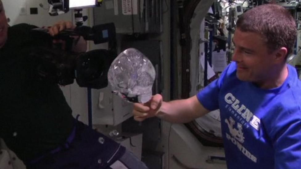 Astronauts play with water in space