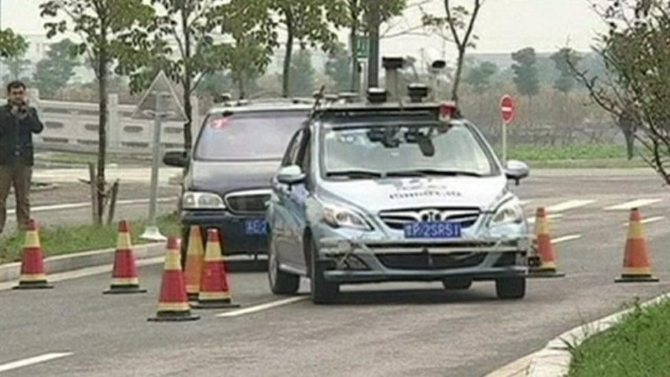 Driverless cars compete in race