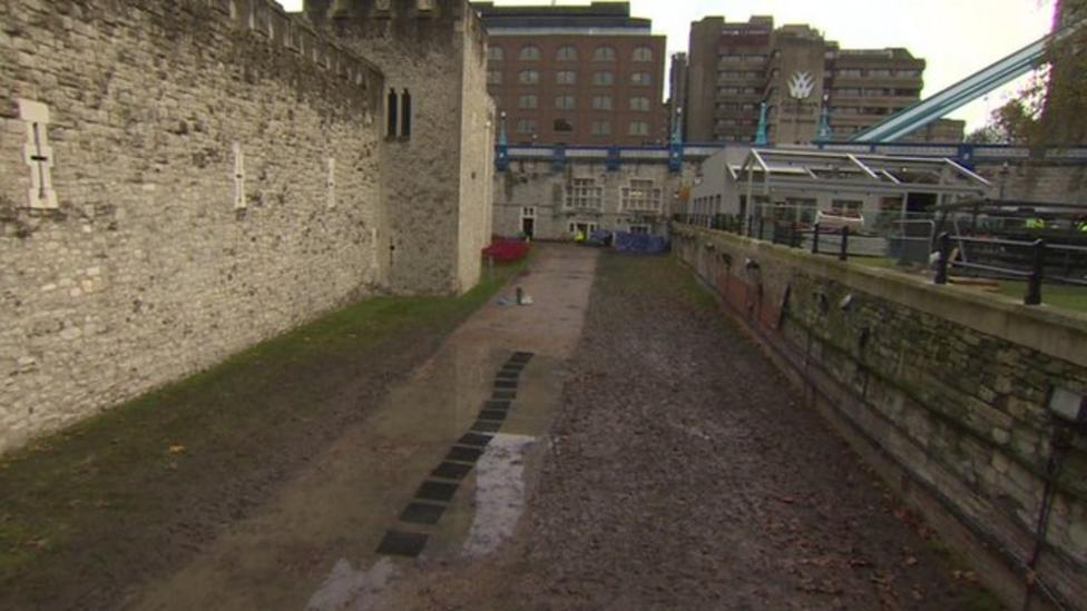 Muddy moat left after poppies removed