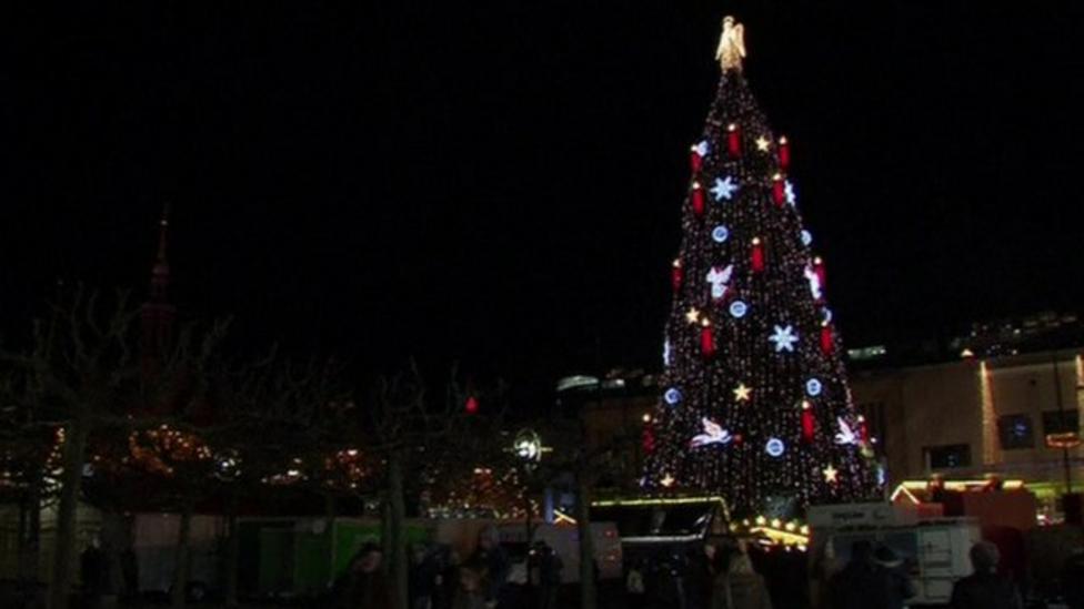 Giant Christmas tree lights up city