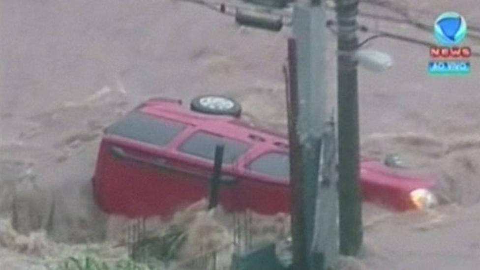 Cars swept away in Brazil floods