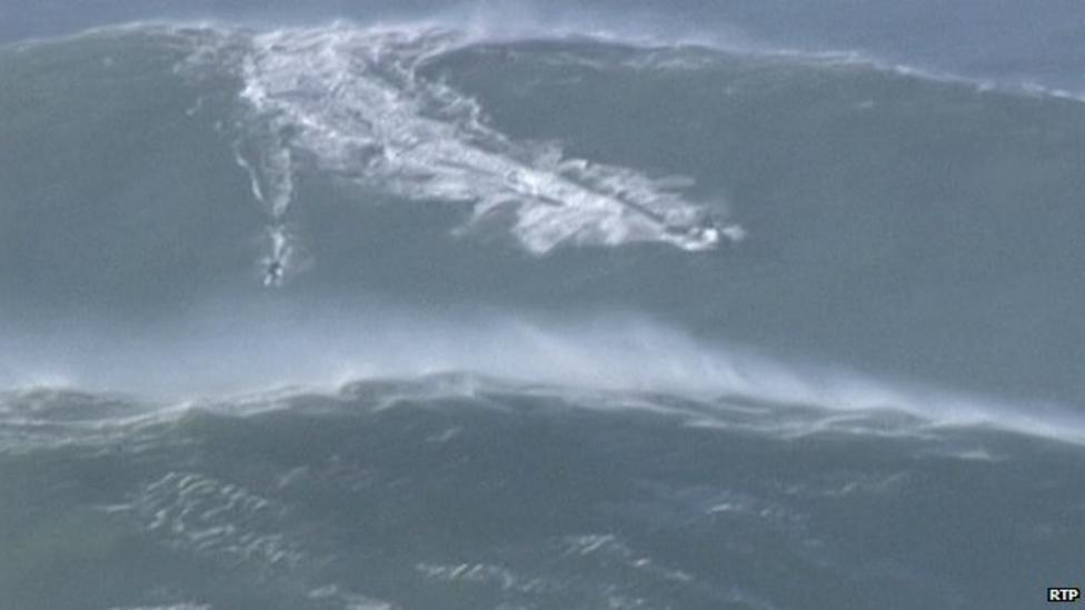 Surfer rides 'weather bomb' wave