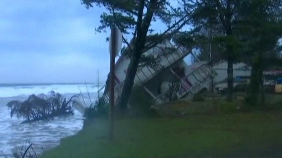 Homes slip into sea as storm pounds US