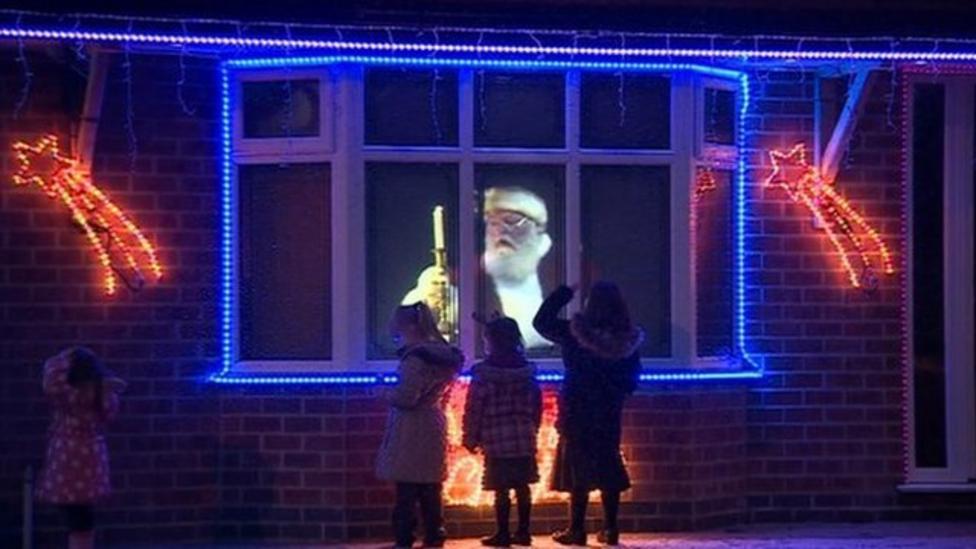 Hologram of Santa in window of house