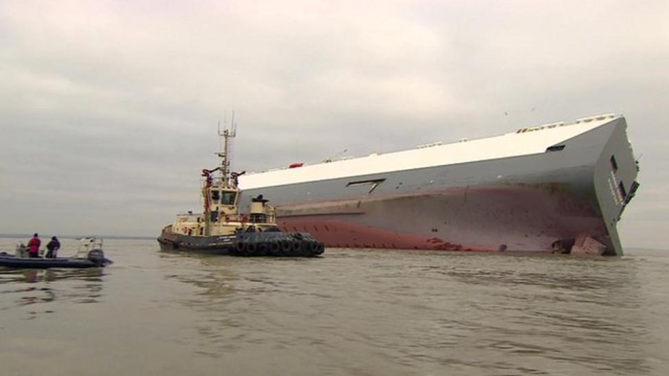 Cargo ship grounded on sandbank