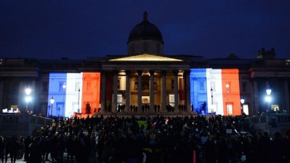 London landmarks lit up for France